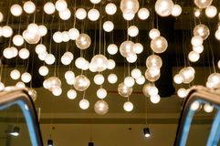 Overhead lights in the form of lit globes Stock Photo