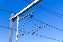Overhead lines on Dutch railway over blue sky Stock Images