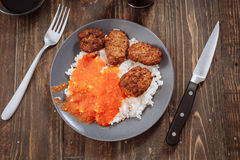 Overhead making rice dish with tomato and meat balls Stock Photos