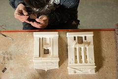 Overhead of a Man Placing Windows on Scale Model Buildings Royalty Free Stock Photos