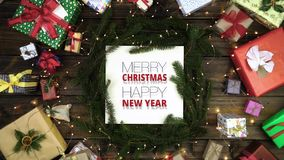 Overhead merry christmas and happy new year message decoration frame on dark gray with pine cones,gifts,red and gold stock video footage
