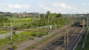 Overhead Metal high voltage electric supply cables over UK railway stock video footage