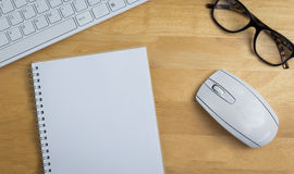Overhead of notebook and glasses Royalty Free Stock Photo
