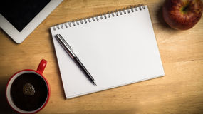 Overhead of notepad and pen Stock Photos