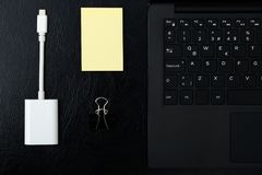 Overhead of office table with laptop, computer keyboard and stic stock image