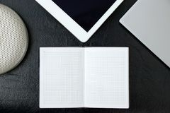 Overhead of office table with notebook, tablet pc, notepads copy stock photo