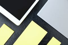 Overhead of office table with notebook, tablet pc and yellow not stock images