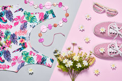 Overhead outfit fashion essentials set, flowers. Overhead outfit Fashion girl clothes set, accessories. Creative hipster look, pastel colors. Stylish gumshoes Royalty Free Stock Photography