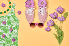 Overhead outfit fashion essentials set, flowers. Overhead outfit Fashion girl clothes set, accessories. Creative hipster look, pastel colors. Stylish gumshoes, t Stock Images