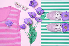 Overhead outfit fashion essentials set, flowers. Overhead outfit Fashion girl clothes set, accessories. Creative hipster look, pastel colors. Stylish gumshoes, t Royalty Free Stock Image