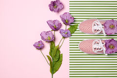 Overhead outfit fashion essentials set, flowers. Overhead outfit Fashion girl clothes set, accessories. Creative hipster look. Stylish gumshoes and purple Royalty Free Stock Photography