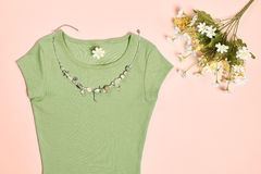 Overhead outfit fashion essentials set, flowers. Overhead outfit Fashion Ladies, accessories. Glamor creative  T-shirt, flowers, necklace, bouquet of camomile Stock Images