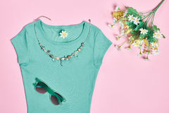 Overhead outfit fashion essentials set, flowers. Overhead outfit Fashion Ladies, accessories. Glamor creative  T-shirt, flowers, necklace, sunglasses, bouquet of Stock Photography