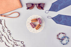 Overhead outfit fashion essentials set, macarons. Overhead outfit Fashion clothes set, macarons french dessert, accessories. Glamor creative, handbag clutch Royalty Free Stock Images