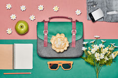 Overhead outfit hipster essentials set, flowers. Overhead outfit Fashion ladies set, accessories. Creative hipster look, pastel colors. Handbag, shorts Royalty Free Stock Photo