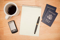 Overhead Pad, Pen, Passports, Coffee and Cell Phon Stock Image