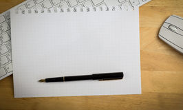 Overhead of page and pen Stock Photo