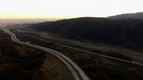 Overhead panoramic shooting of mains in mountain valley. Overhead panoramic video of main highways in foggy mountain valley and the sky stock footage