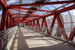 Overhead passage. Bolted steel beams. Painted in red. Interior.  royalty free stock images