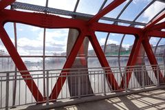 Overhead passage. Bolted steel beams. Painted in red. Interior.  stock image