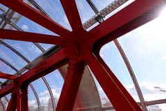 Overhead passage. Bolted steel beams. Painted in red. Interior.  stock photos