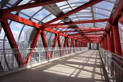 Overhead passage. Bolted steel beams. Painted in red. Interior.  stock photography