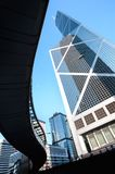 An overhead pedestrian walkway frames the Bank of China Tower, H. CENTRAL, HONG KONG - JAN 15, 2014 - An overhead pedestrian walkway frames the Bank of China royalty free stock photos