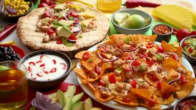 An overhead photo of an assortment of many different Mexican foods on a table. An overhead photo of an assortment of many different Mexican foods, including stock video