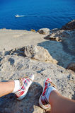 Overhead photo of feet on a background of seaview. Women feets view from above. Exploring, travelling, tourism, leisure. Royalty Free Stock Photos