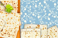 An overhead photo of Jewish matzah on the chopping board. The illustration of linden tree branch and matzah for jewish passover. H. Oliday illustration of matza Stock Photo