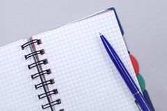 Overhead photo of an open journal notebook with a pen, top view, a diary on a gray background with a place for text.  stock photos
