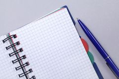Overhead photo of an open journal notebook with a pen, top view, a diary on a gray background with a place for text.  royalty free stock photography