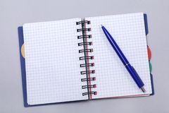 Overhead photo of an open journal notebook with a pen, top view, a diary on a gray background with a place for text.  royalty free stock photos