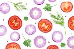An overhead photo of sliced purple onion, red tomatoes, peppercorns, dill and parsley leaves isolated on white. Top view, photo stock image