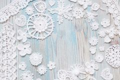 An overhead photo of white vintage handmade Irish lace crochet knitting christmas and valentine day elements. Hearts, flowers, royalty free stock photos