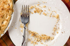 Overhead of Pie Plate, Fork and Copy Spaced Crumbs Royalty Free Stock Photo