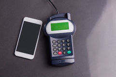 Overhead of pin terminal and smartphone Stock Image