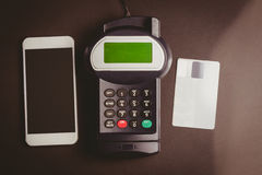 Overhead of pin terminal and smartphone Royalty Free Stock Image