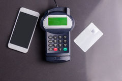 Overhead of pin terminal and smartphone Stock Photo