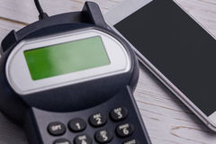Overhead of pin terminal and smartphone Stock Photography