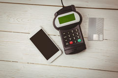 Overhead of pin terminal and smartphone Royalty Free Stock Photography