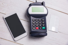 Overhead of pin terminal and smartphone Stock Photos