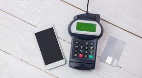 Overhead of pin terminal and smartphone Royalty Free Stock Images