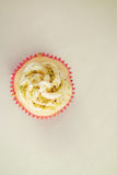 Overhead of pistachio vanilla cupcake with space for text Royalty Free Stock Photography