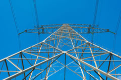 Overhead power line in a blue sky. In sunlight Stock Photography