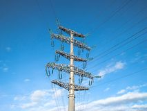 Overhead power line with electrical wires. At blue sky background royalty free stock photos