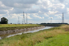 Overhead power lines span the River Nene in Cambridgeshire Stock Images