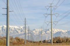 Overhead power lines in sunny Eagle Mountain Utah stock photos