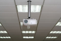 Overhead projector under the ceiling in boardroom. At office Stock Photography