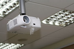 Overhead projector under the ceiling in boardroom. At office #4 Royalty Free Stock Image